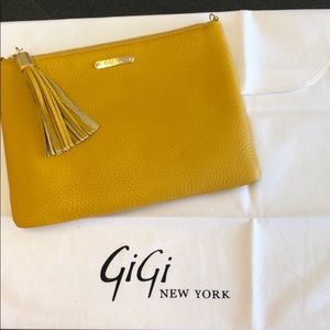 Gigi NewYork mustard colored textured clutch